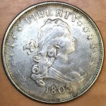 Historic, genuine 1803 Draped Bust design U.S. silver dollars in Very Fine condition are currently valued at about $3,000.  This counterfeit 1803-dated dollar was recently offered in a Hong Kong flea market for less than $3.