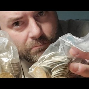Searching through bags of silver half dollars