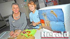 Caroline McCallum taught pupils at Elliminyt Primary School about different fabrics and sewing techniques for the Corangamite Waterwatch fibre-artwork competition. An exhibit at Ballarat this month will show Emily Robinson's winning artwork.