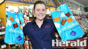 Blane's Newspower staff member Emma Gibson is preparing Darrell Lea show bags for this weekend's Colac Show. Blane's newsagency has been putting together the show bags since the early 1970s. The show bags are full of sweet treats and are for sale at the show.