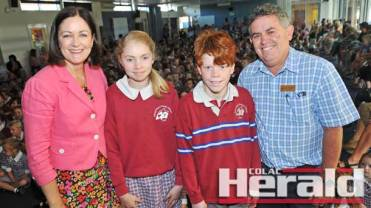 Federal MP Sarah Henderson announced Sacred Heart Primary School would receive a $1.06-million boost to improve its staff and administration space. Ms Henderson made the announcement at the school's first assembly for the year on Friday and she is pictured with Tanisha Clarke, Joseph O'Farrell and school principal Jack Lenaghan.