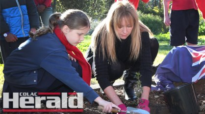 Alvie Consolidated School pupil Charlotte Little helped teacher Amanda Falkiner plant a Gallipoli oak tree at the school. The tree commemorates the Anzac centenary.