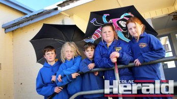 Winchelsea Primary School pupils Sam Phelps, Jett Price, Charlie Phelps, Eve Mawson and Sammi Kuchenmeister regularly face the prospect of being drenched due to the school's ageing gutters.