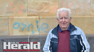 """Colac RSL's Brian Lloyd is disgusted someone wrote the word """"oshie""""in two different colours on the rear of the Colac War Memorial. Colac Cleaning Services removed the graffiti on Monday afternoon."""