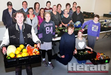Colac Specialist School student Erik Clayton, front left, works with other students, staff and community food program supporters to provide fruit and vegetables to Colac and district families. The school's Community Food Program is a nominee in the 2015 National Disability Awards, with winners announced next month.