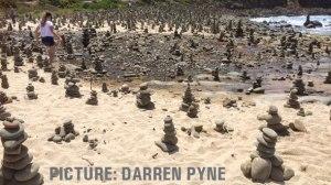 Visitors have built hundreds of rock piles at a beach at Carisbrook Creek near Apollo Bay.