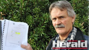 CONCERNED: Water campaigner Malcolm Gardiner, pictured with reports revealing high toxity in the Otways,.