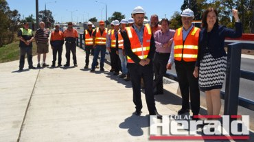 """Corangamite MP Sarah Henderson, pictured right after the completion of roadworks at Winchelsea, says she is proud of the federal and state investment in the Princes Highway from Geelong to Colac, despite criticism in a """"city-centric"""" report."""