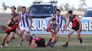 South Colac's Alex McVilly, centre, breaks away from Irrewarra-Beeac footballers, from left, Mitch Cirillo, Jake Theodore and Rob Elborough. McVilly is supported by teammates Nick Cole and Daniel Roberts.  PICTURE SUPPLIED BY FIONA BRETT