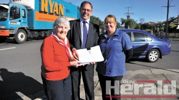 STRONG SUPPORT: Colac campaigner Ruth Spokes, Polwarth MP Richard Riordan and Colac Pharmacy's Karen Parker hope the State Government will act on a community petition signed by more than 2500 people calling on traffic lights at the intersection of Murray and Armstrong streets.