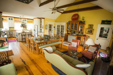 The antique-laden country kitchen offers breakfast to customers.