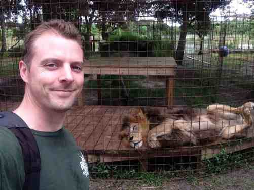 Chris with Joesph a male lion - Big Cat Rescue