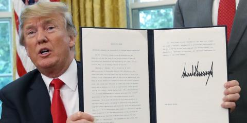 president donald trump displays executive order washington dc june 20 2018