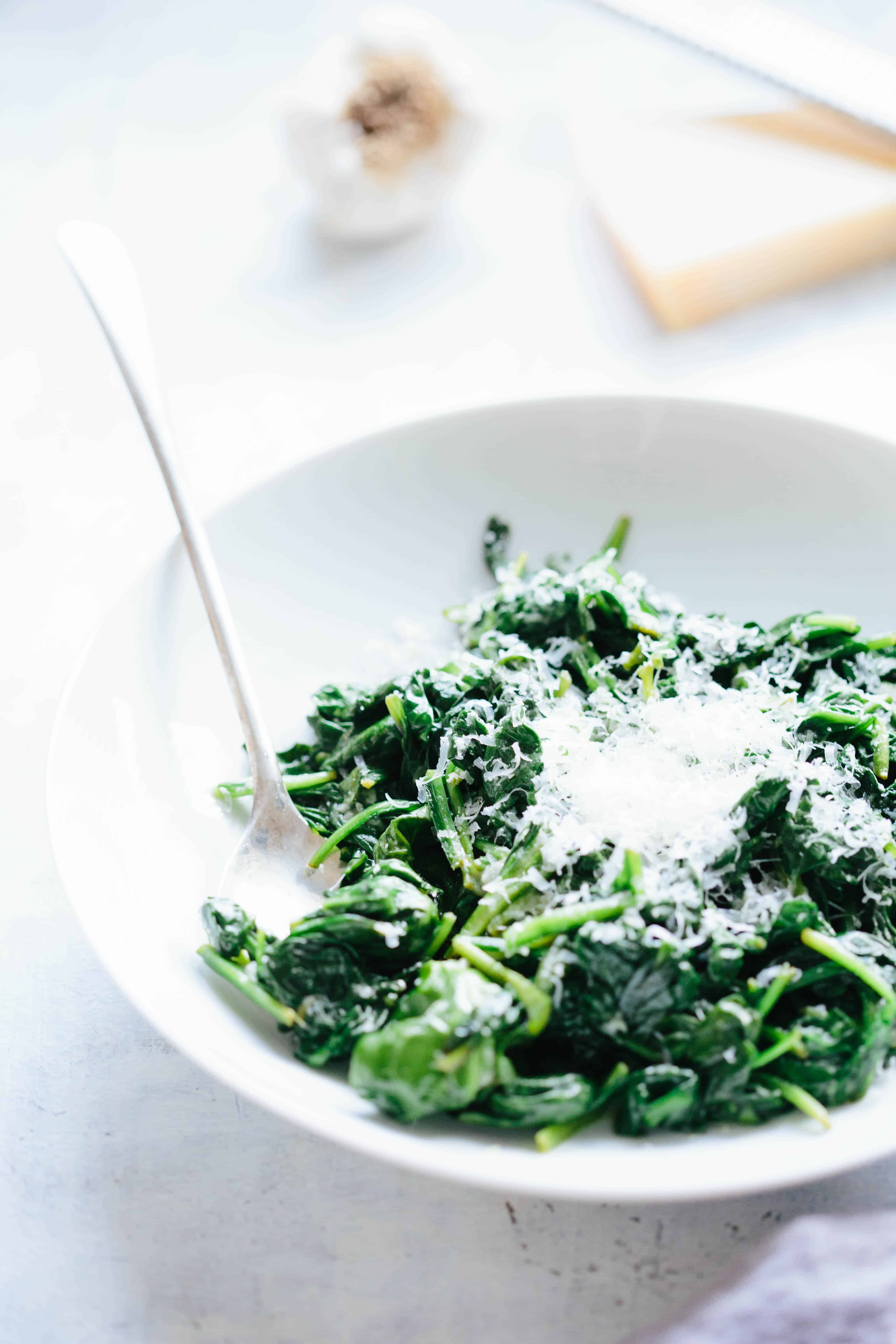 This Spinach with Butter + Parmesan is a simple, yet delicious recipe takes 5 minutes to make and uses only 4 ingredients! #easy #spinach #vegetable #side #recipe #quick #Italian #cheese | ColeyCooks.com