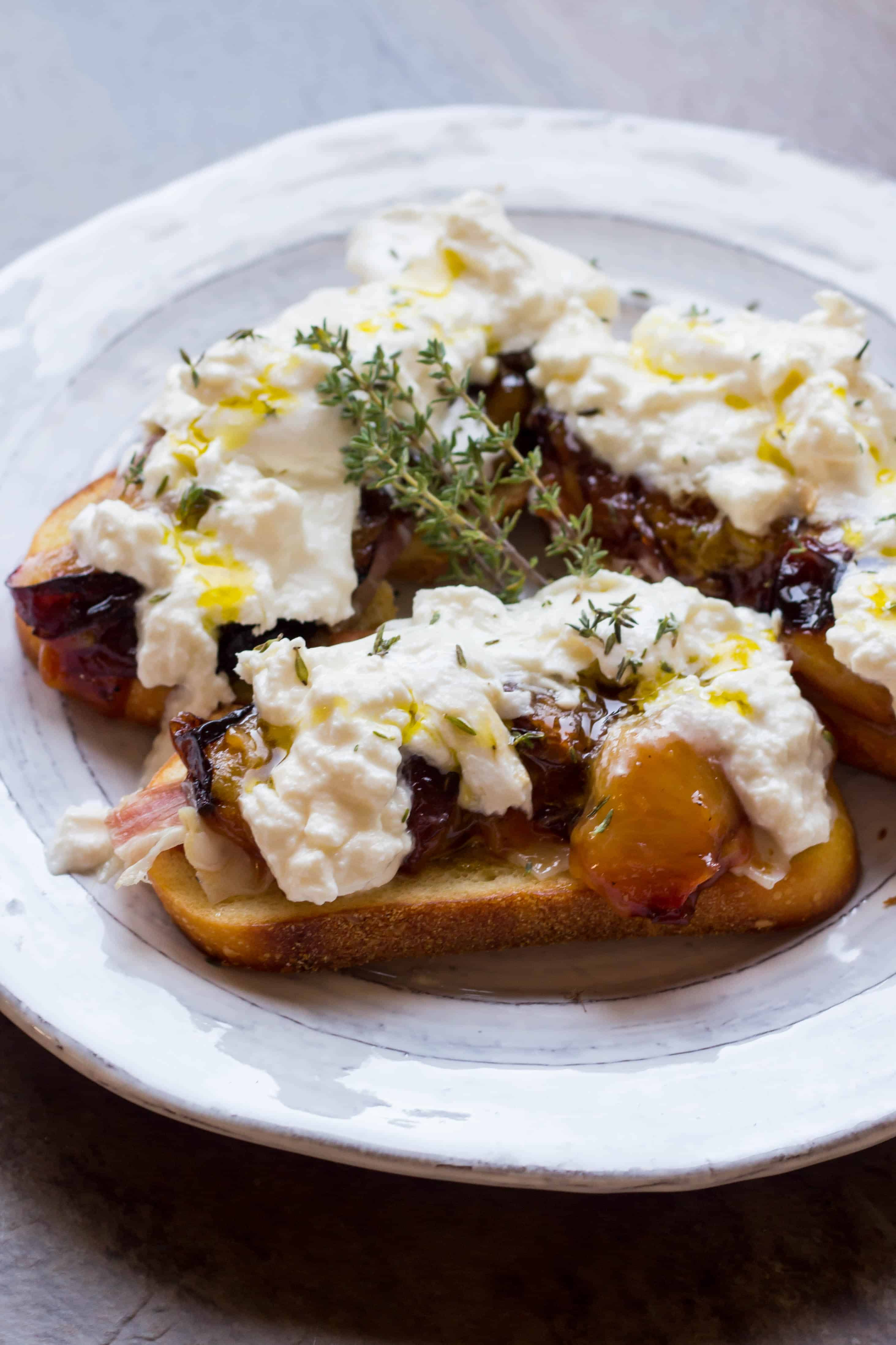 Honey Roasted Plum Crostini with Burrata and Prosciutto (Video!)
