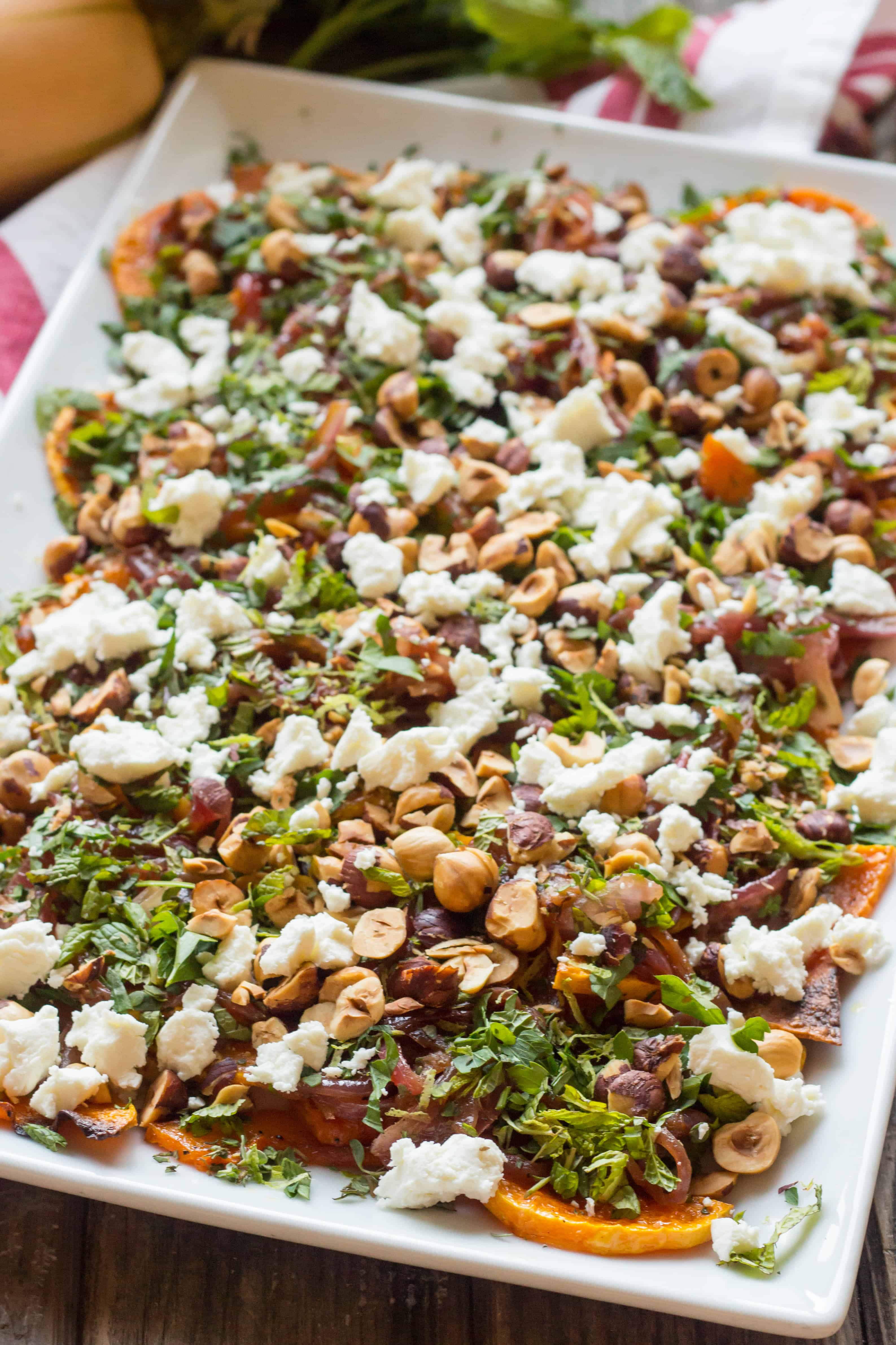 Roasted Butternut Squash with Goat Cheese, Hazelnuts + Lime. An awesome vegetarian main or unique Thanksgiving side! | ColeyCooks.com
