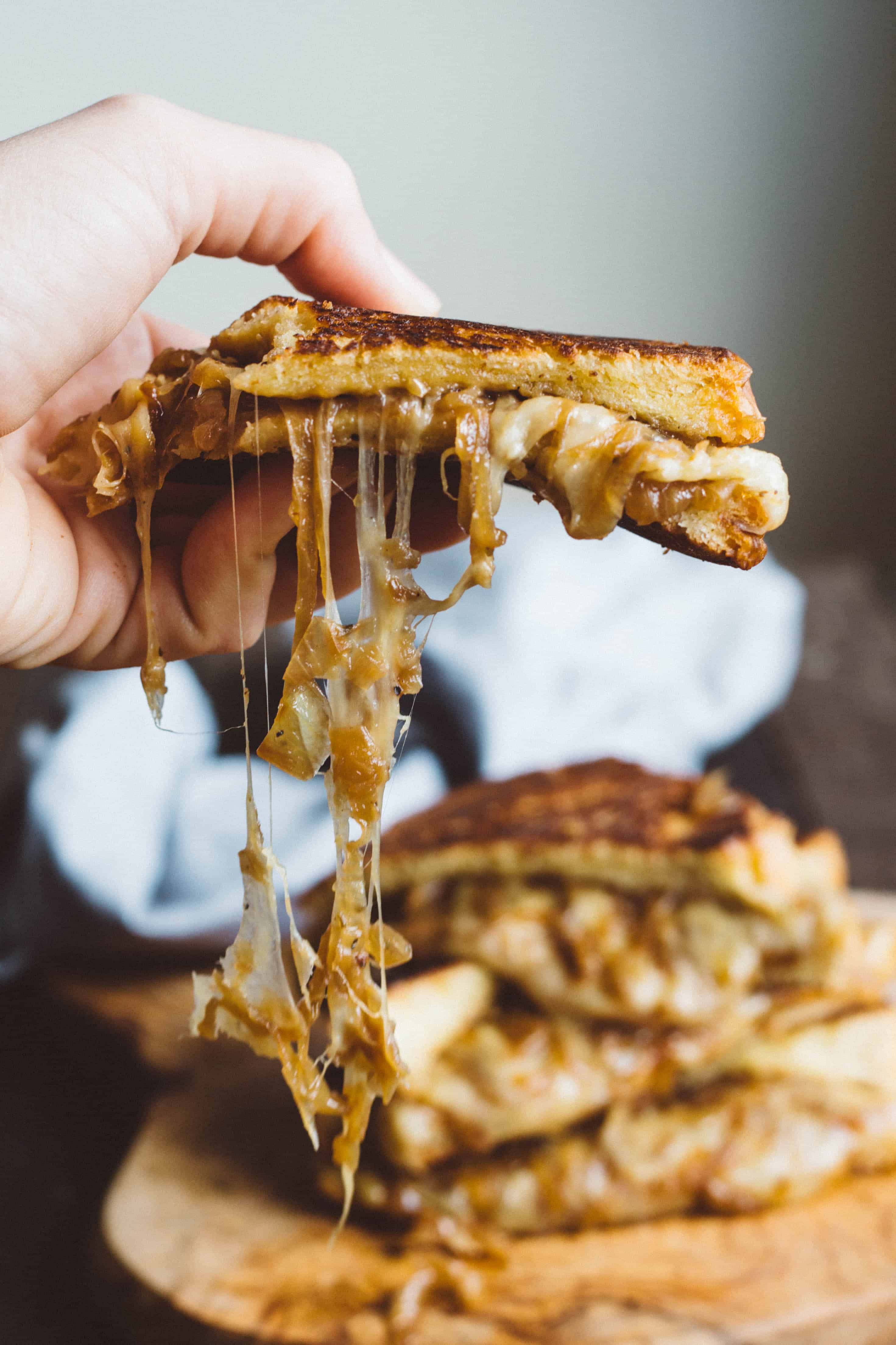 French Onion Grilled Cheese (Video!) - Overflowing with caramelized onions and melty, cheesy goodness! | Coley Cooks