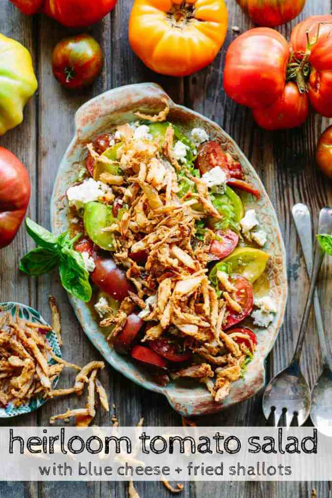 Heirloom Tomato Salad with Blue Cheese + Fried Shallots | Best tomato salad recipe ever! Juicy heirloom tomatoes, creamy blue cheese and crispy fried shallots in a sweet sherry vinaigrette. #heirloom #tomatoes #recipe #garden #summer #salad