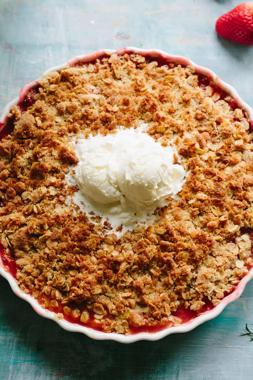 APRICOT STRAWBERRY RHUBARB CRISP   Easy spring / summer dessert recipe! Buttery oat crumble topping over jammy sweet tart fruit. #easy #fruit #crisp #dessert #recipe   ColeyCooks.com