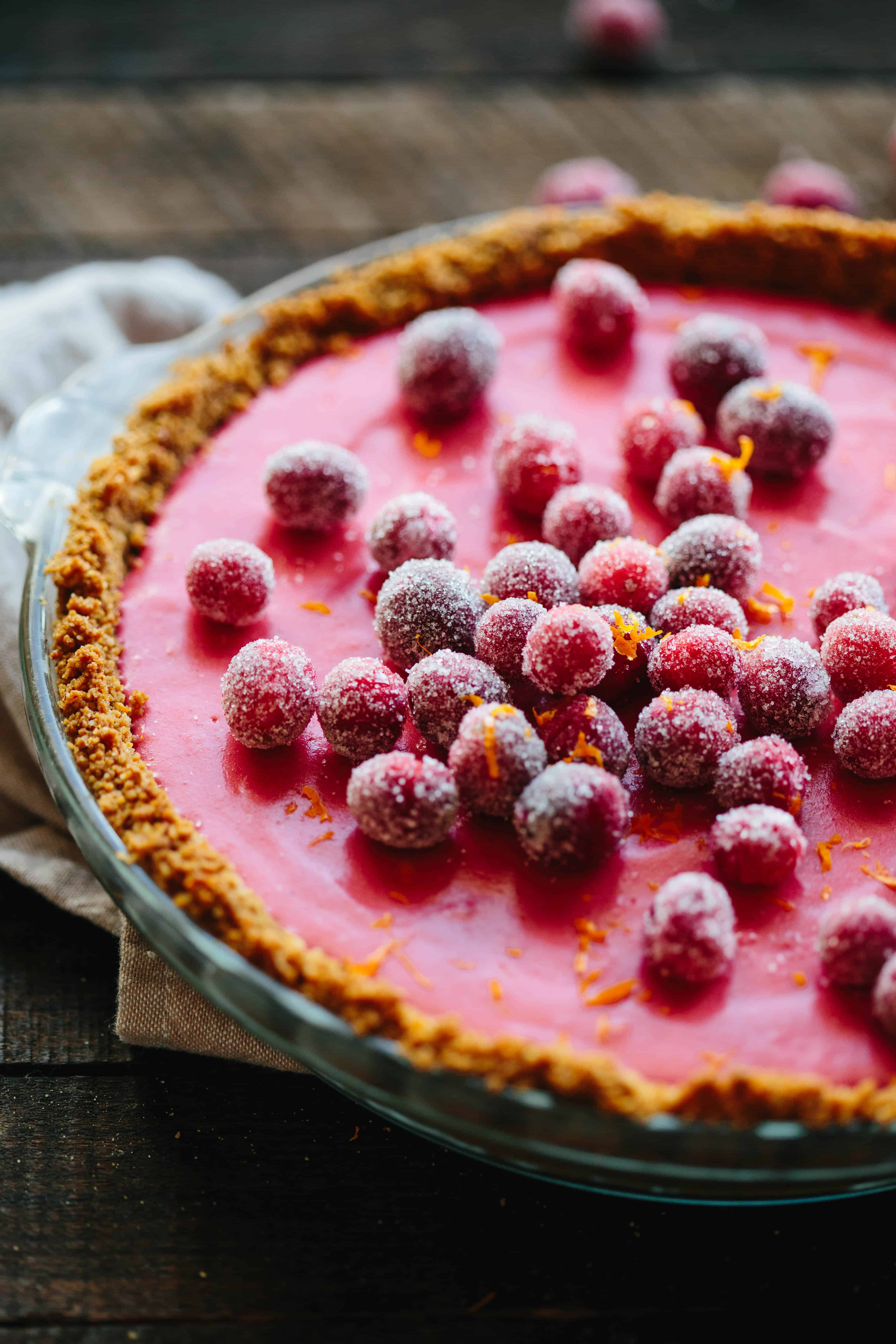 CRANBERRY MEYER LEMON PIE with gingersnap crust   Think key lime pie, but better. A beautiful and unique holiday dessert perfect for Thanksgiving! #Thanksgiving #entertaining #recipe #cranberry #meyerlemon #pie   ColeyCooks.com