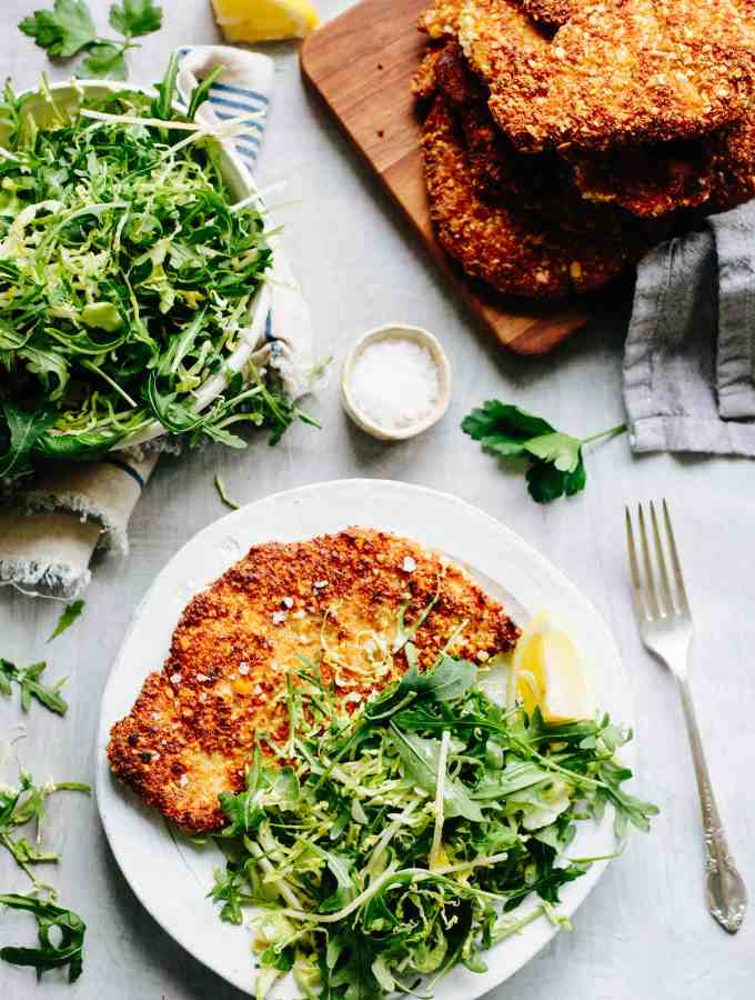 Almond Chicken Cutlets with Apple, Arugula + Brussels Sprout Salad. Gluten free, pan fried chicken cutlets, flavored with Dijon mustard and served with a crisp and refreshing apple, shaved Brussels sprout and arugula salad! #easy #chicken #cutlet #recipe #dijon #apple #brussels #salad #arugula #glutenfree #almond #crispy #healthy | ColeyCooks.com