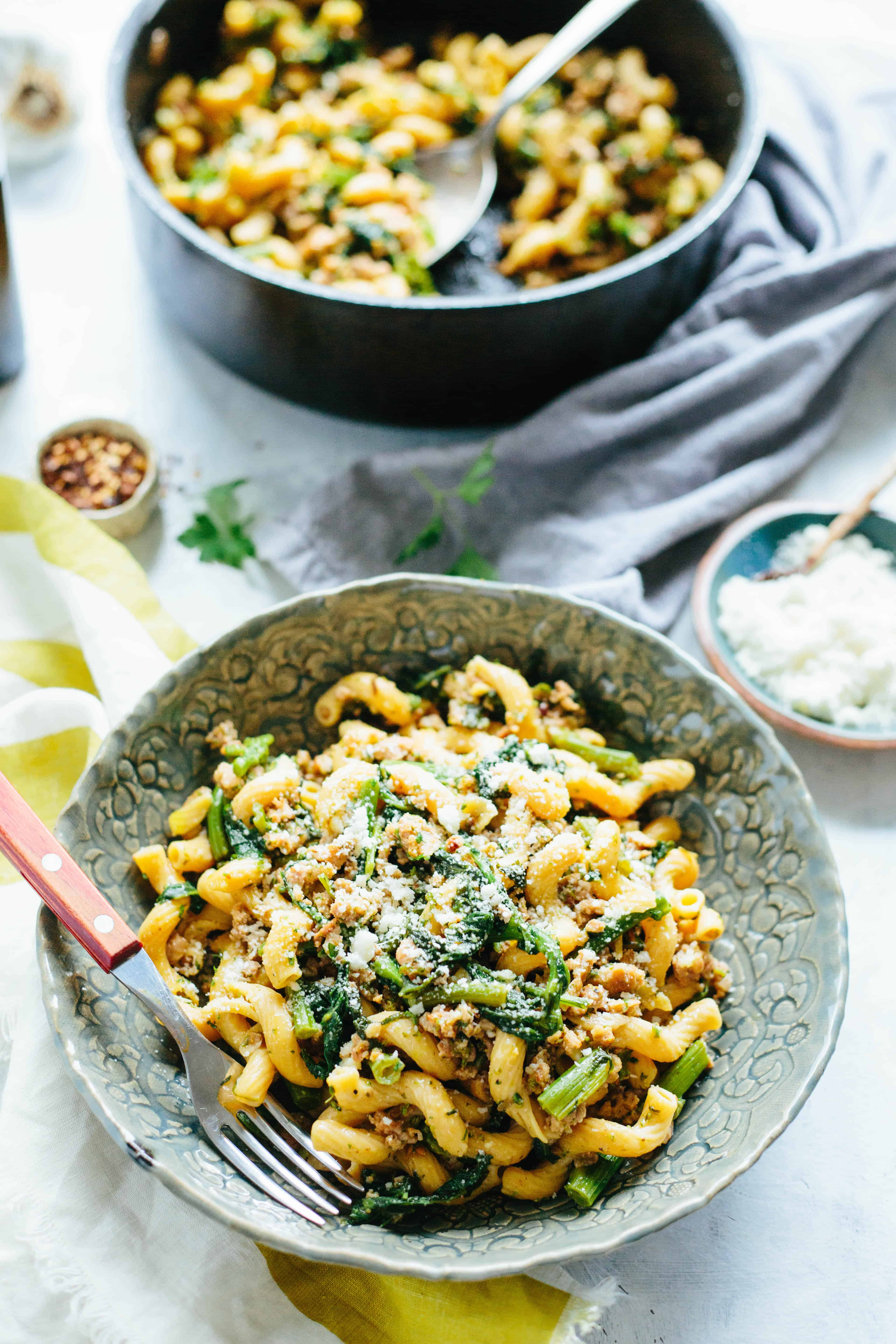 This easy recipe for Chick Pea Pasta with Italian Sausage + Broccoli Rabe is a healthy gluten free dinner that can be on the table in 20 minutes! #easy #glutenfree #pasta #italian #recipe #broccoli #sausage | ColeyCooks.com