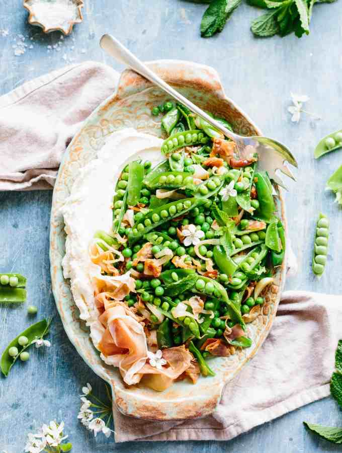 This easy recipe for Peas with Prosciutto + Ricotta is the perfect healthy side dish for spring. Great recipe for Easter, Mother's Day or any springtime occasion! #easy #spring #side #vegetable #recipe #Italian #peas #prosciutto #ricotta   ColeyCooks.com