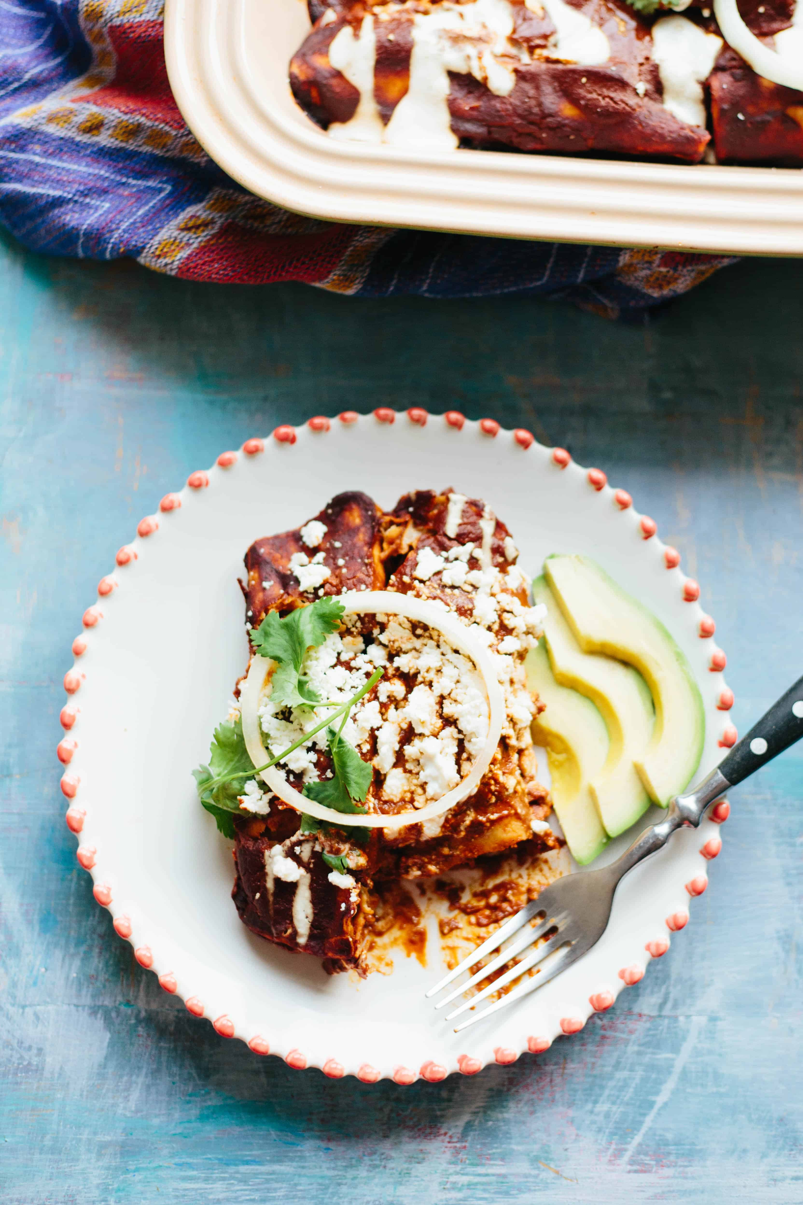 This recipe for Chicken Mole Enchiladas is easy to make, yet boasts an incredible amount of flavor. It's a healthy, satisfying and delicious Mexican recipe that everyone will love! #easy #authentic #Mexican #enchiladas #mole #chicken #recipe | ColeyCooks.com