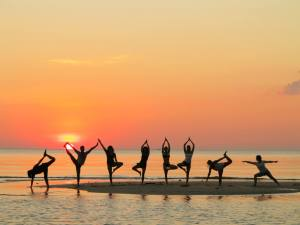 Sunset yoga in Thailand (the 5th silhouette from the left, that's me).