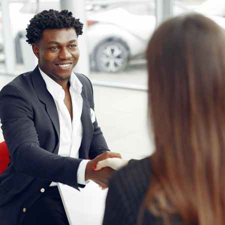 excited buyer shaking hands with agent