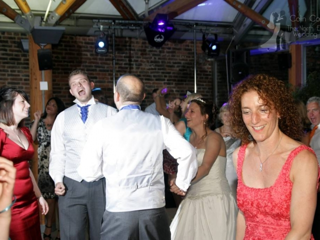 Bridal Party and Guests having fun and dancing at Claire & Gavin's Alnwick Garden Wedding Disco