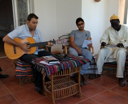 Michel Ezzat who graduated in Theology, playing guitar at the St Andrew's retreat