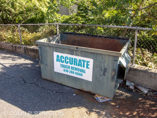 Uncovered dumpster with stagnant water