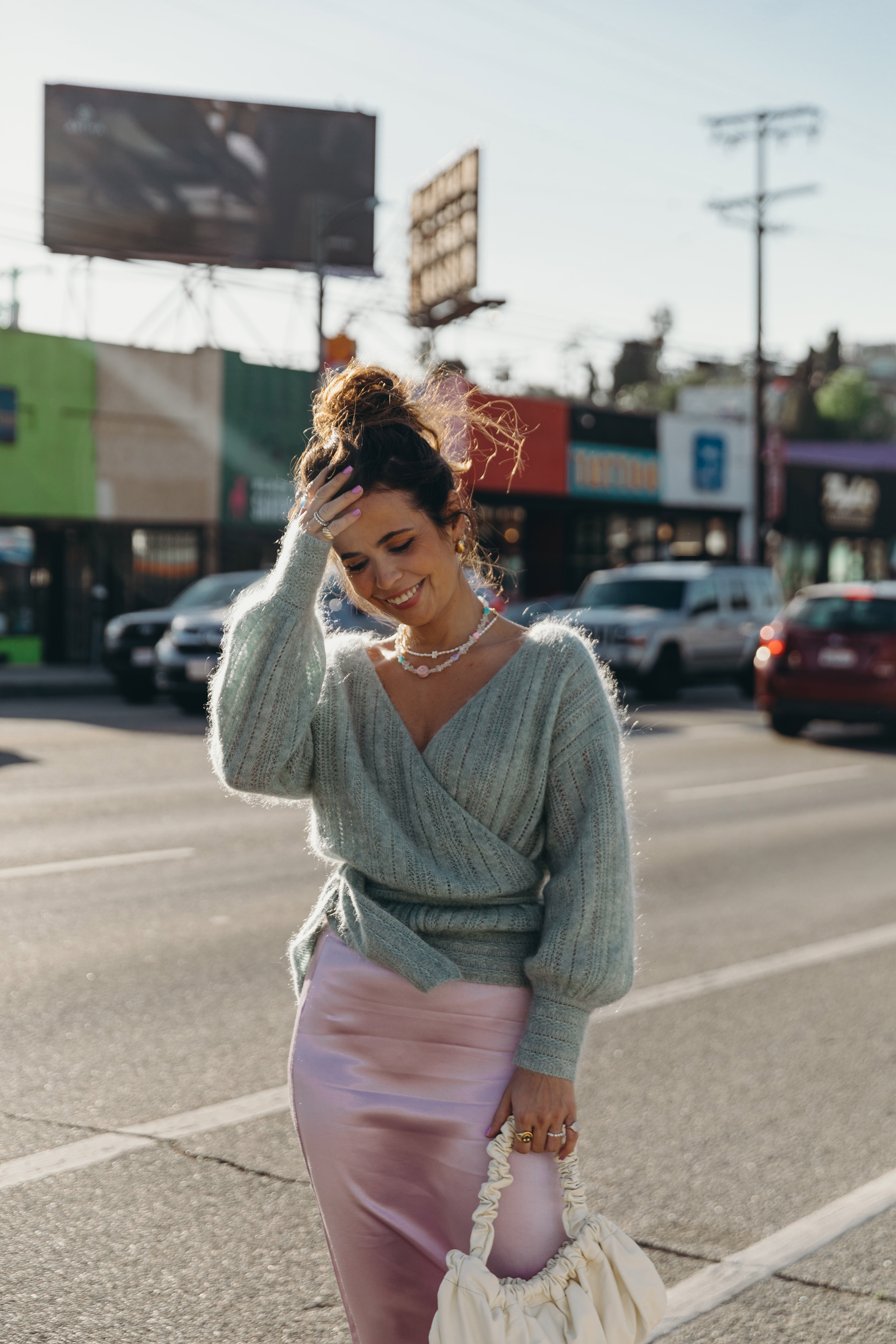 Sara from Collage Vintage wearing a Sézane lavender midi skirt and a mint knit-sweater
