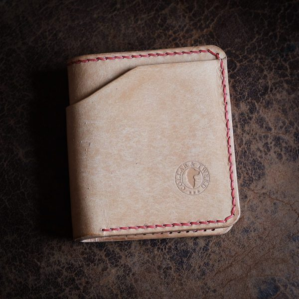 Grizedale hand made wallet in Badalassi Carlo Bone Natural Pueblo Leather, with other EDC items and hand stitched red saddle stitching.
