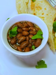 Pinto beans were transformed into these Vegan Ranch Style Beans, accompanied by a Quesadilla, and garnished with a few torn pieces of cilantro.
