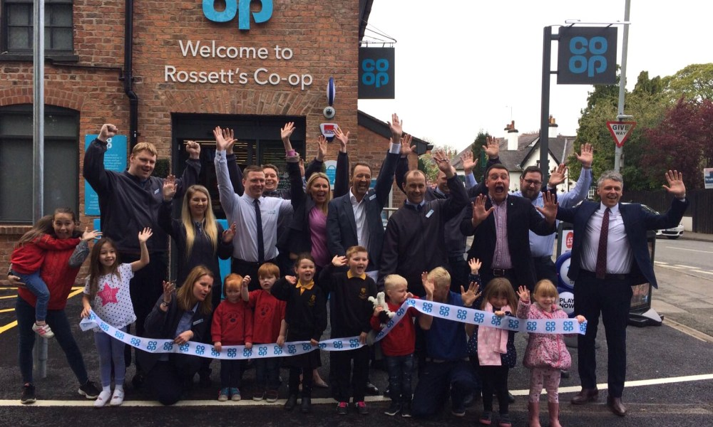 Group CEO Steve Murrells, members of the Rossett community and store colleagues throwing their hands in there as they open our new store