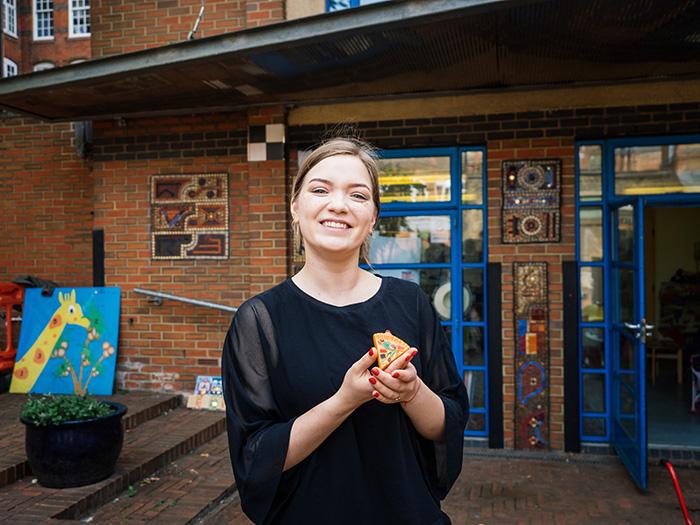 Member Anastasia outside St Hilda's Community Centre