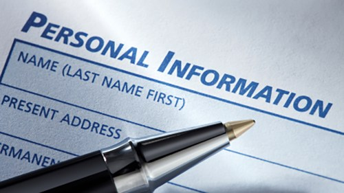 Picture of pen above a blank 'personal information' form