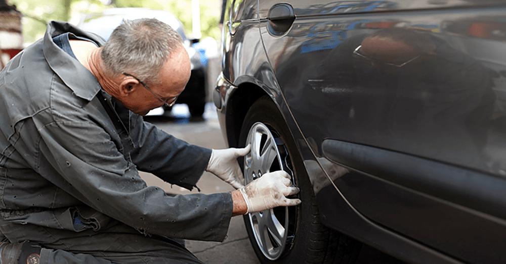 Mechanic fixing a wheel