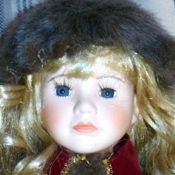 Christmas Musical Ice-Skater Doll face close up