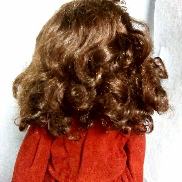 Brunette Doll On Stand hair close up