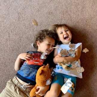 Siblings giggling together