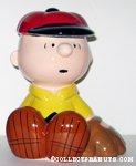 Charlie Brown sitting with baseball mitt Bank