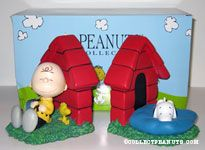 Charlie Brown, Snoopy and  Woodstock sleeping by doghouse Bookends