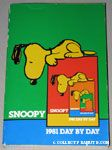 Snoopy peering over edge of book '1981' Snoopy Day by Day Calendar