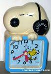 Snoopy wearing headphone and Woodstock chirping Radio Clock