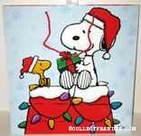 Snoopy giving Woodstock Christmas gift on doghouse Gift Bag