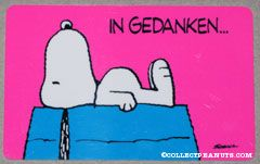 Snoopy laying on doghouse 'In gedanken... bin ich ganz bei dir!' Wallet Greeting Card