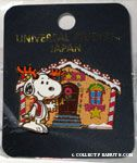 Snoopy standing in front of Christmas Gingerbread house Pin
